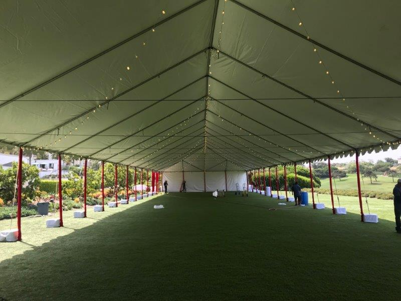 Tent with Red Pole Covers and String Lighting Image 1